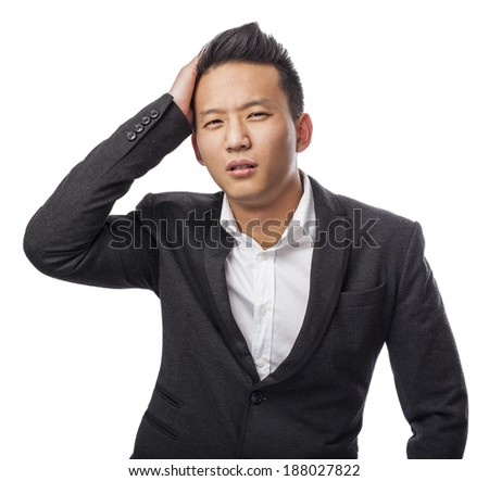 Worried young asian man with his hand over his head