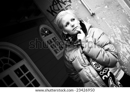 Worried young blonde close portrait. - stock photo