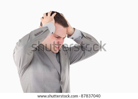 Worried young entrepreneur against a white background - stock photo