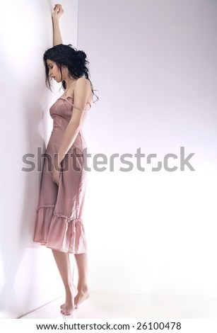 Worried young girl in a empty room - stock photo