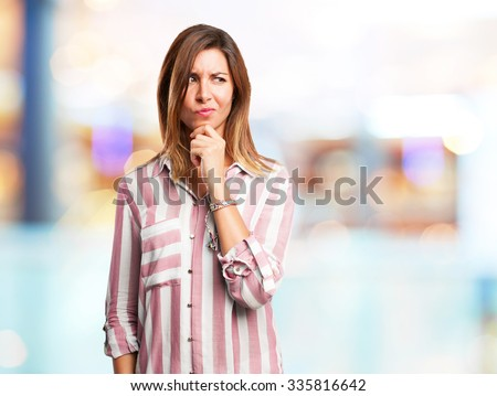 worried young woman doubting - stock photo