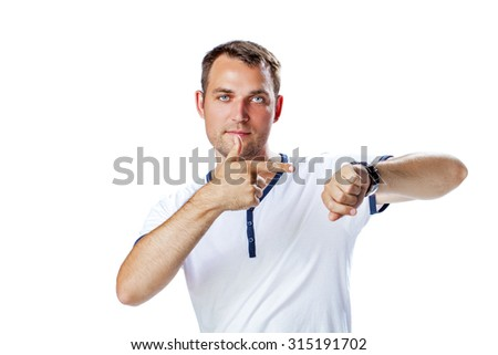 Worrier man running out of time looking his watch isolated on a white background  - stock photo