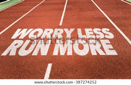 Worry Less Run More written on running track - stock photo