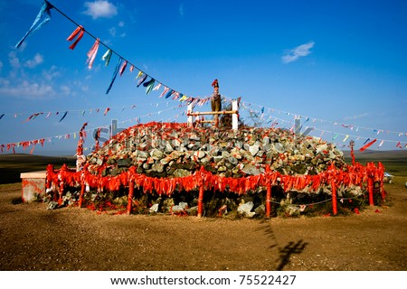 Worship area in Inner Mongolia with colourful flags. - stock photo