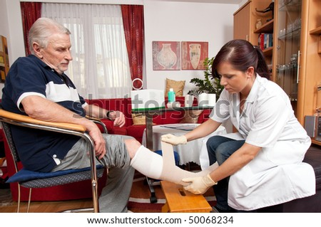 Wound care by a nurse - stock photo