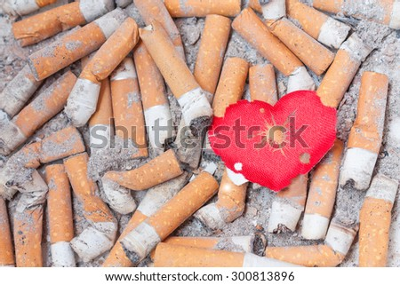 Wounded heart on cigarette bulls. Stop smoking now