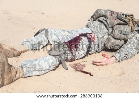 Wounded US paratrooper airborne infantrymen in the desert - stock photo