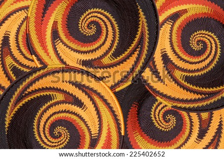 Woven baskets as a background made with plastic coated telephone wire by African craftsmen - stock photo