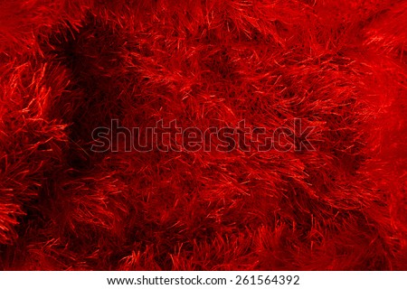 Woven fabrics of yarn cropped. Red background. - stock photo