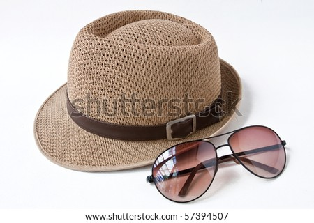 Woven hat with sunglasses - stock photo