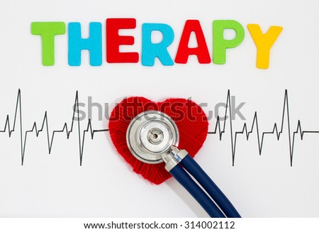 Woven red heart and the stethoscope on the cardiogram. Therapy - stock photo