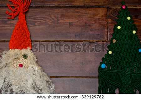 Woven Santa Claus and Christmas tree on the wooden background