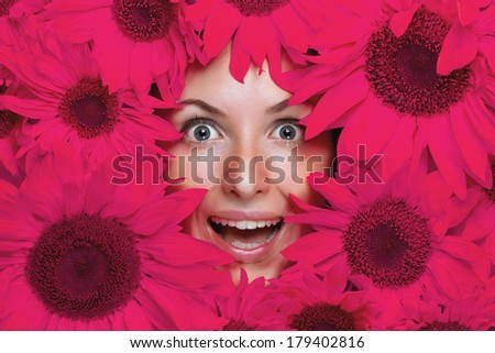 Wow effect! Young woman with flowers - stock photo