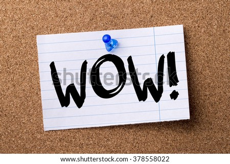 WOW! - teared note paper pinned on bulletin board - horizontal image - stock photo