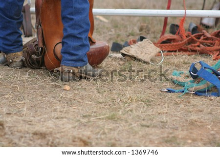 wrangler or cowboy gets prepared at the local rodeo - stock photo