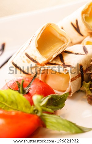 Wrap with mixed vegetables, cheese and sauxe - stock photo