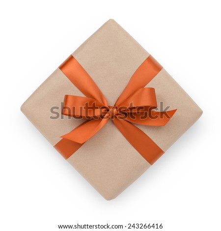 wrapped brown present box with orange ribbon bow, isolated on white - stock photo