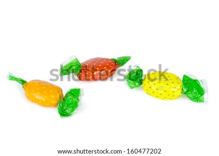 Wrapped candies or sweets on a white background. Clipping path included.