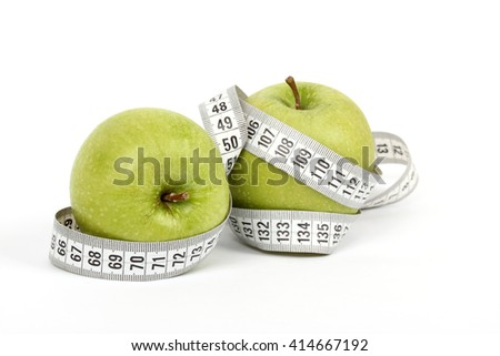 wrapped centimeter diet green apple on a white background