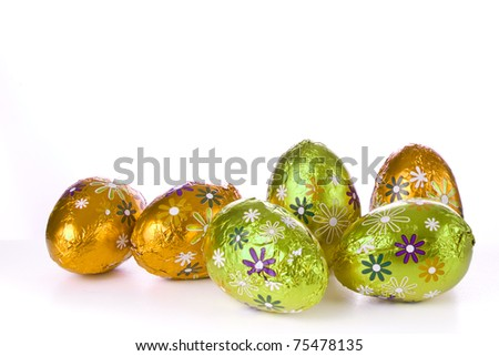 wrapped chocolated easter eggs isolated - stock photo