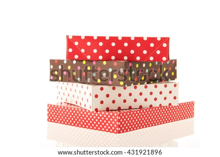 Wrapped gifts in dotted boxes isolated over white background - stock photo