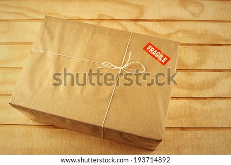 Wrapped package on table top - stock photo