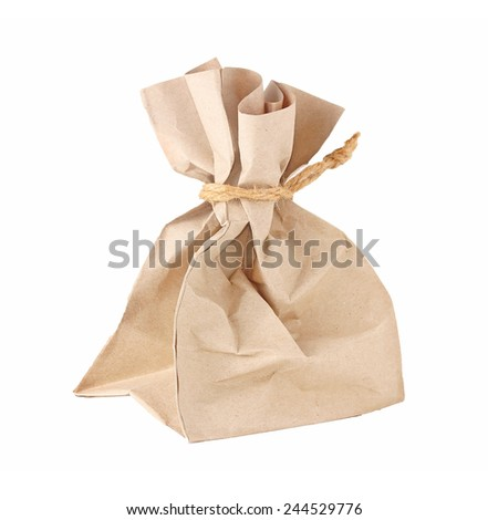 wrapped paper bag on a white background - stock photo