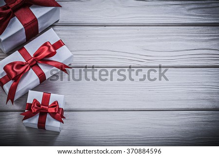 Wrapped present boxes on wooden board copyspace holidays concept. - stock photo