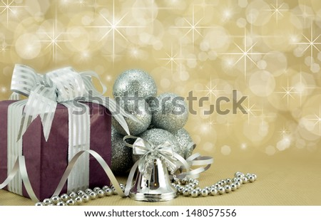 Wrapped present with festive ornaments