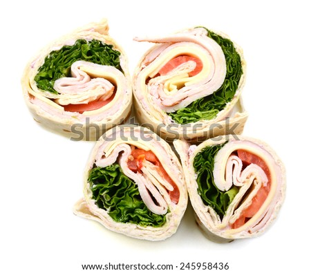 wrapped tortilla sandwich rolls cut in slice on white background  - stock photo