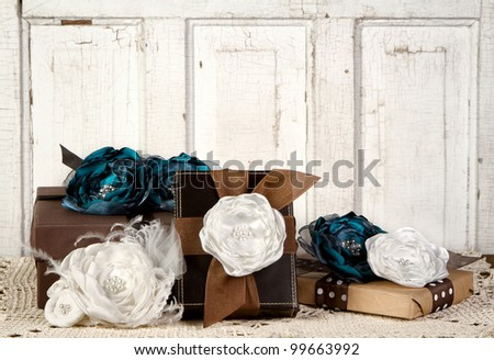 Wrapped vintage packages with vintage flowers against a vintage door - stock photo