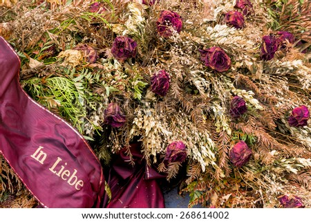 wreath at the barbara cemetery comes to be forgotten. out of sight out of mind. - stock photo