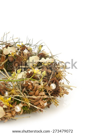 Wreath of dry branches, spices and orchid flowers isolated on white background - stock photo