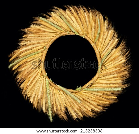 Wreath of ears of wheat isolated on black - stock photo