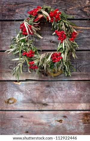 wreath of leaves with rowan on wooden grunge background/ - stock photo