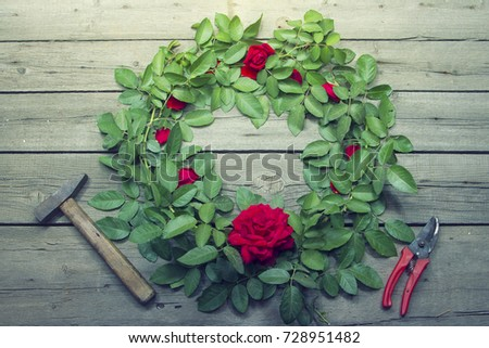 wreath of roses on a wooden background