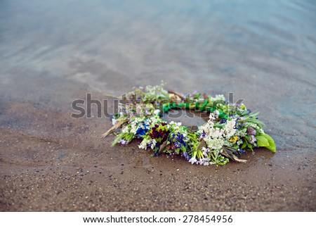 Wreath on water, tradition Kupala night pagan rituals - stock photo