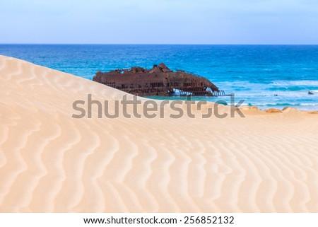 Wreck boat on the coast of boa vista in Cape Verde, Cabo Verde - stock photo