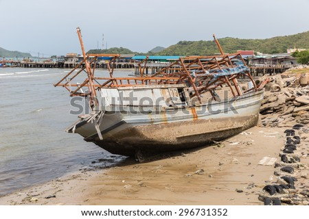 wreck fishing boat at east coast of Thailand - stock photo