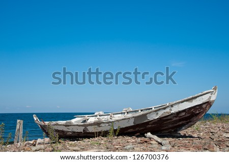 Wreck of an old fishing boat on the coast of the Swedish island of Oeland - stock photo