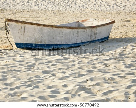 wreckage boat on beach - stock photo