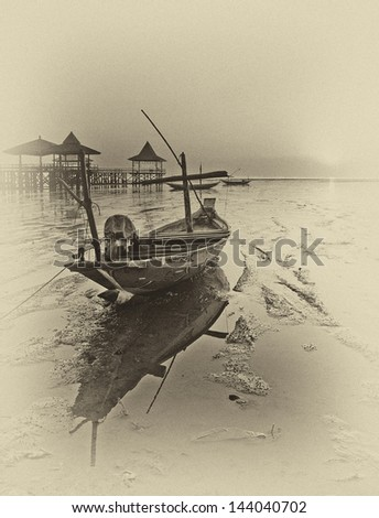 Wrecked boat at receding shore
