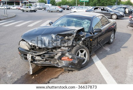 Wrecked car in the city, traffic background - stock photo