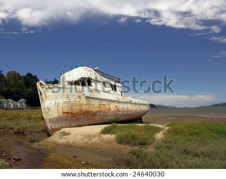 Wrecked fishing boat, Point Reyes, California, USA - stock photo