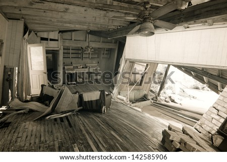 wrecked home interior after natural disaster - stock photo