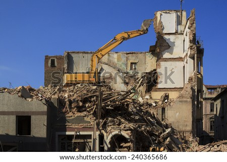 Wrecking crane on debris - stock photo