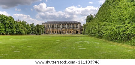 Wren Library Scenic view of wren library with green lawn and hedges in foreground, Trinity College, Cambridge, England. - stock photo