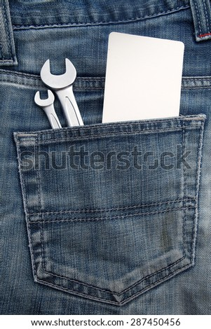 wrench in the back jeans pocket, vintage color - stock photo