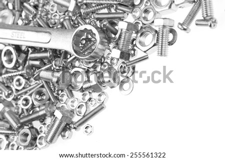 Wrench on nuts and bolts. Copy space