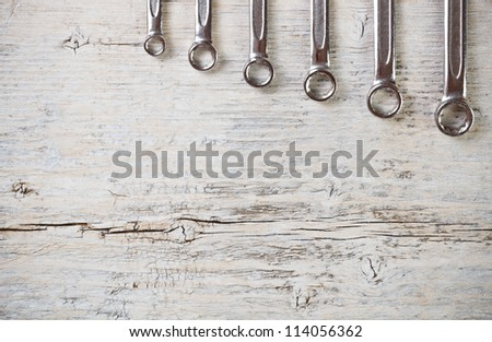 Wrench spanners tools on wood background - stock photo